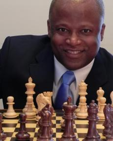 grandmaster maurice ashley with chess set